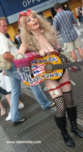 The [deflated/aged] Naked Cowgirl. Not only knocking off the Naked Cowboy but also knocking off a previous Naked Cowgirl. Girl should not be running around in skivies but hell, power to her.